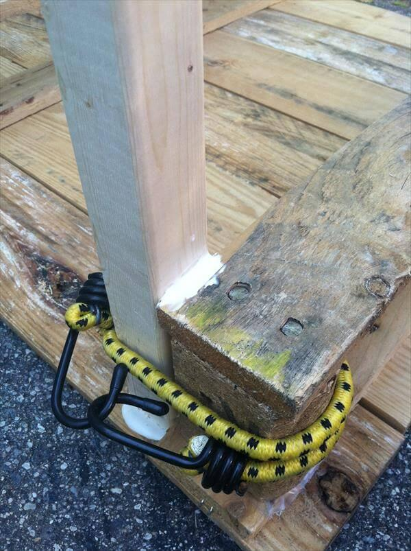 adding glue to pallet garden table legs