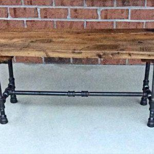 repurposed pallet and black iron pipe bench