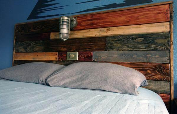 recycled pallet headboard with reading light fixture