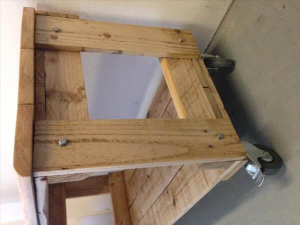 handmade pallet media unit with book storage