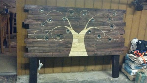 reclaimed pallet and glass bottles headboard
