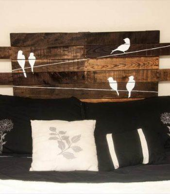 recycled pallet headboard with painted bird wall art