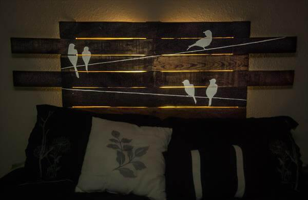 upcycled pallet headboard with bird art and LEDs
