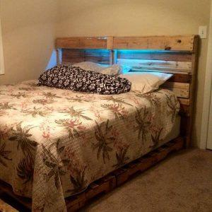 upcycled wooden pallet bed and headboard with lights