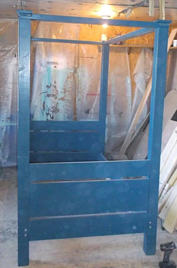 sturdy blue painted pallet canopy bed