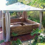 Recycled pallet u shape couch under gazebo