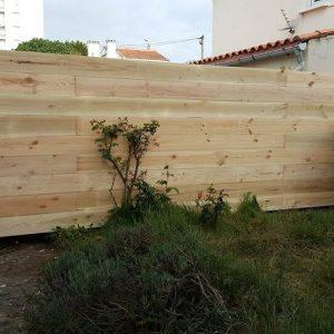 reclaimed pallet garden or backyard fence wall