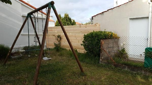 upcycled pallet garden or backyard fence wall