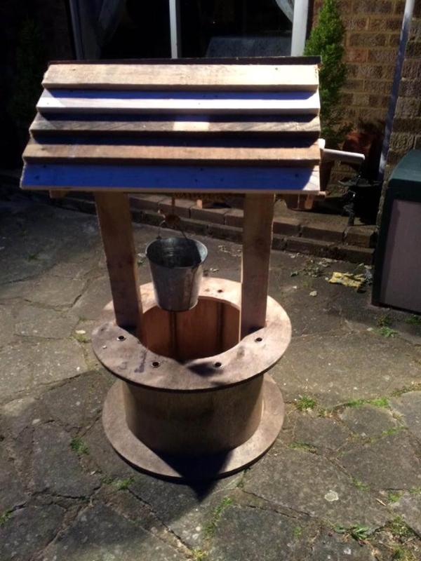 garden wishing well decor made of pallets