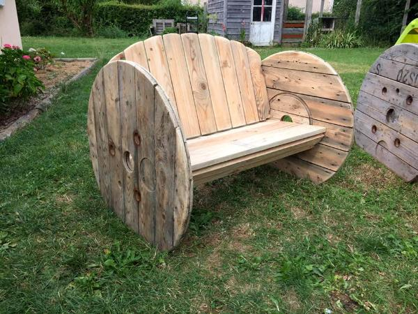 upcycled wooden pallet and old spool bench