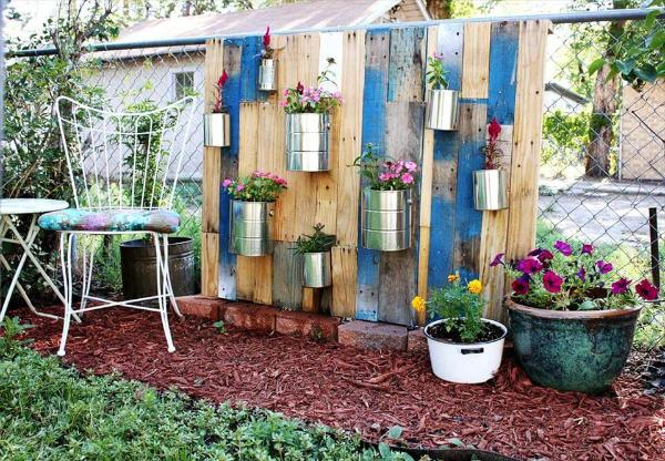 reclaimed pallet and old tin can vertical garden