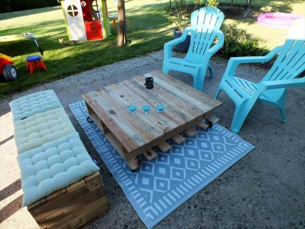 cushioned wooden bench and coffee table made of pallets
