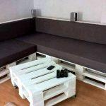 stack white painted pallet L-sofa with black cushion