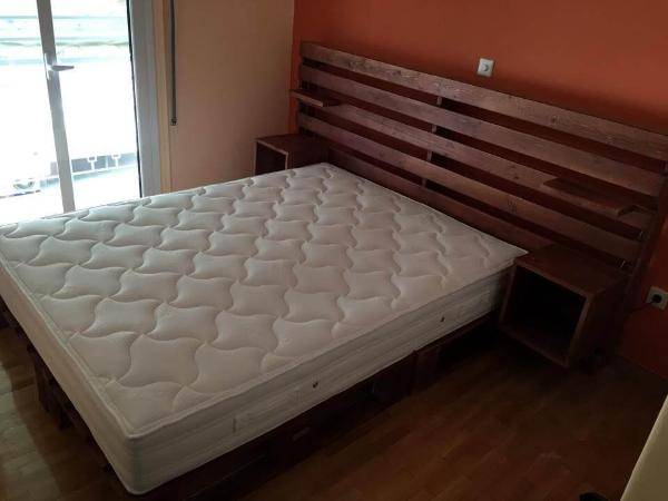 palled bed with storage headboard