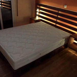 wooden palled bed with storage headboard