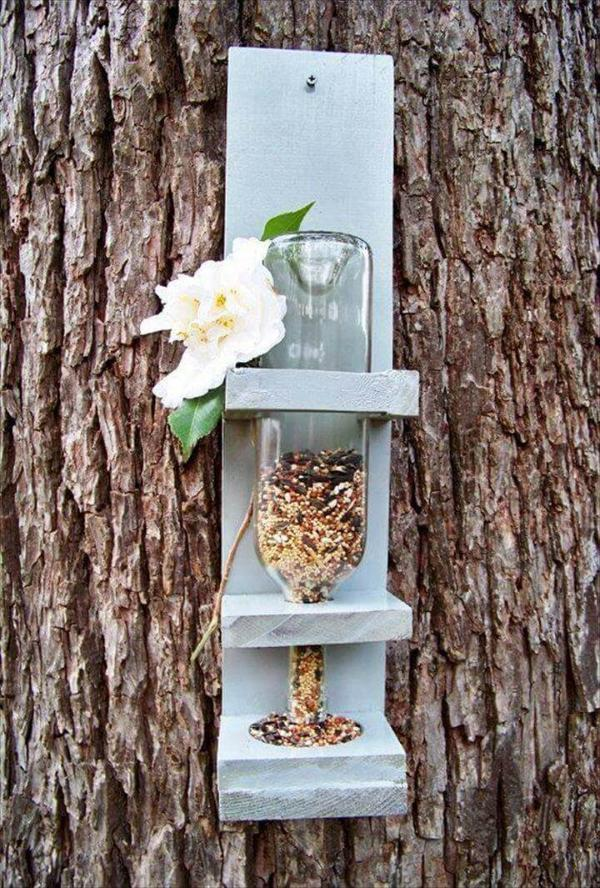 pallet and old glass bottle bird feeder