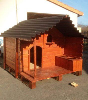 wooden pallet dog house with chevron shingled roof