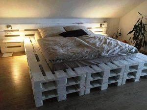 white painted stacked pallet bed